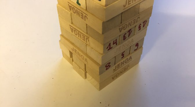 A tower of blocks with written numbers in different colors